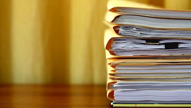 Report books on a desk