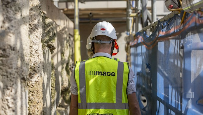 Man wearing a hivis jacket and helmet