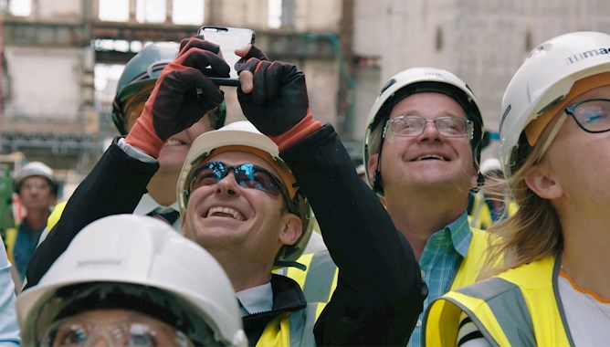 Mace Construction Worker Taking a Photo on his Phone - Mace Group