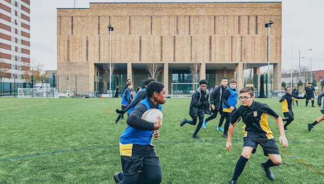 Boys playing rugby at school - Mace Group