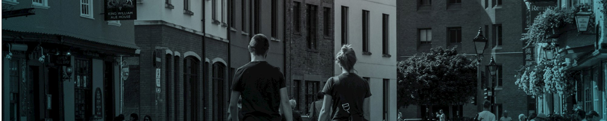 Couple Holding Hands Whilst Walking - Mace Group