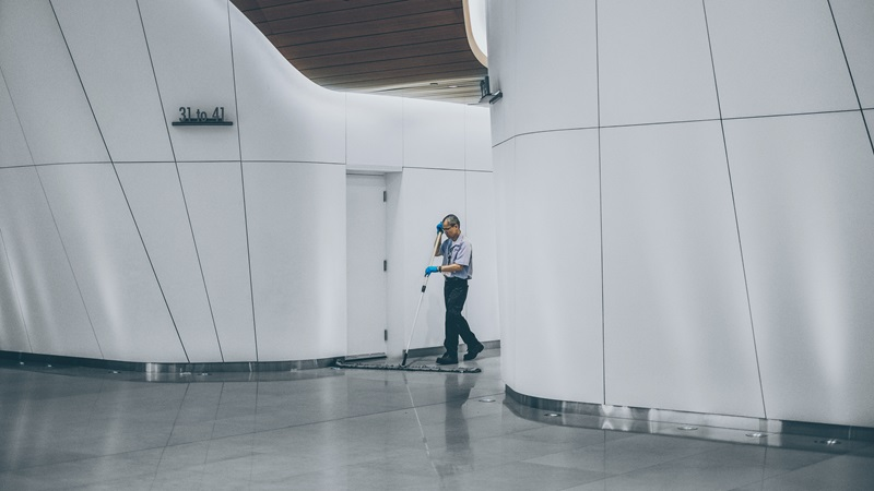 Male Cleaner Mopping a Building Floor - Mace Group
