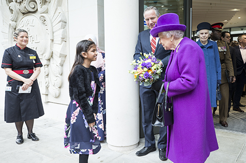 Her Majesty The Queen Speaking to a Young Girl - Mace Group