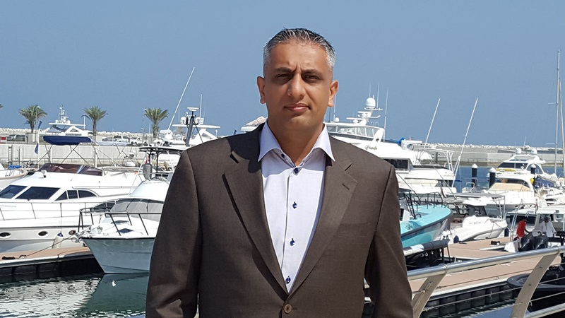 Portrait of Naveed Haque, Luxury Yachts in the Background - Mace Group