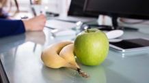 Banana and apple on a table