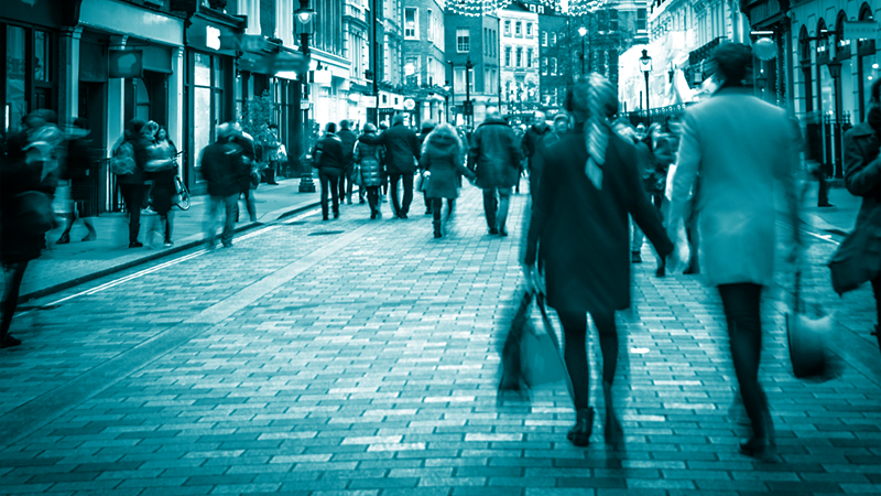 people walking with a blue filter