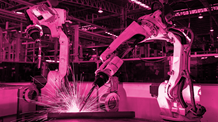 machines at work with a pink filter