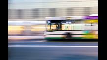 Bus driving along a city road