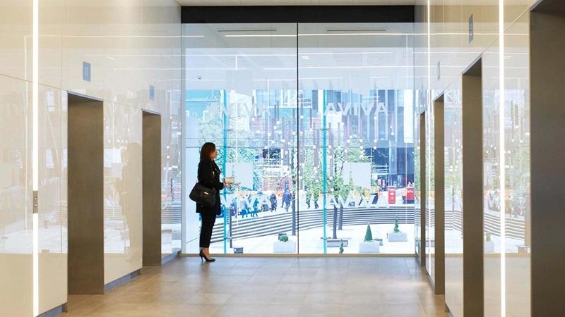 Aviva Building - Female Waiting for Lift - Mace Group