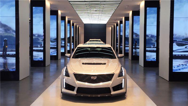 White Cadillac Car Inside Showroom - Mace Group