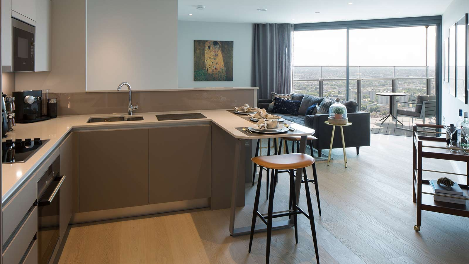 Kitchen and living room within furnished apartment - Mace Group