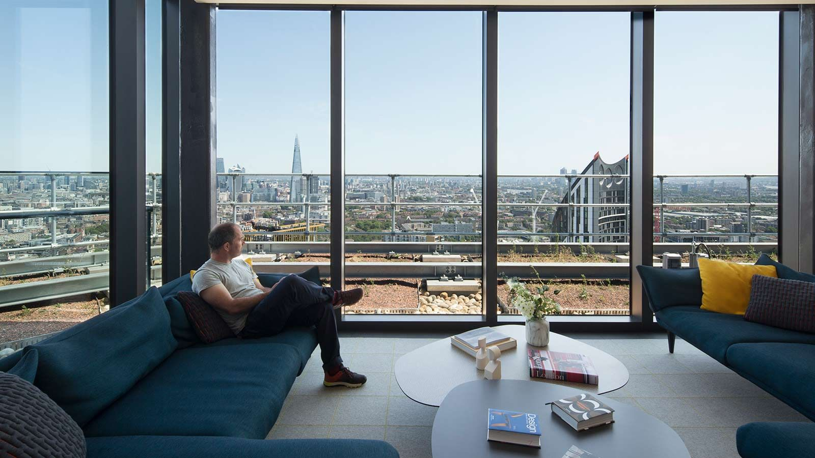 Resident enjoying view in sky lounge - Mace Group