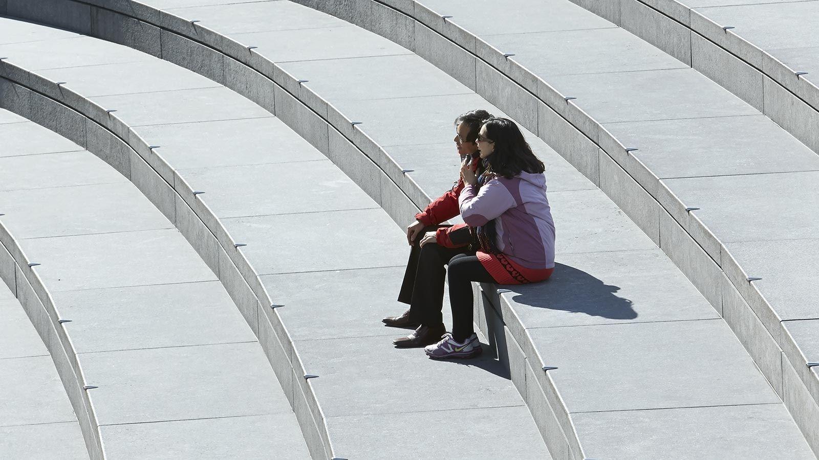 People Sitting on London City Hall Steps - Mace Group