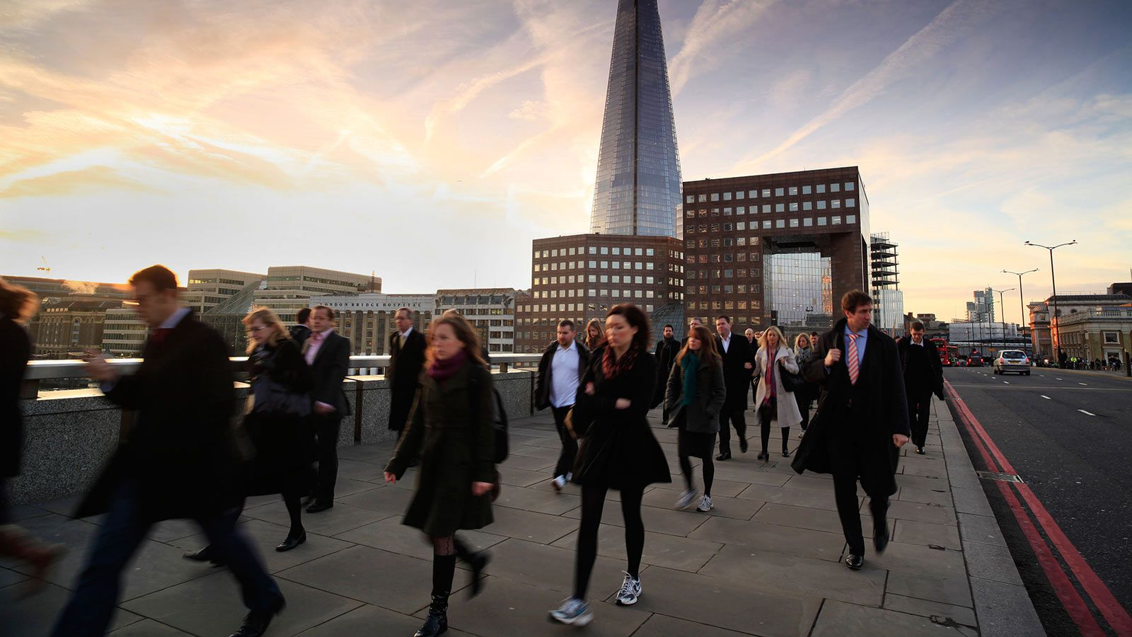People Walking on London Bridge With The Shard in the Background - Mace Group