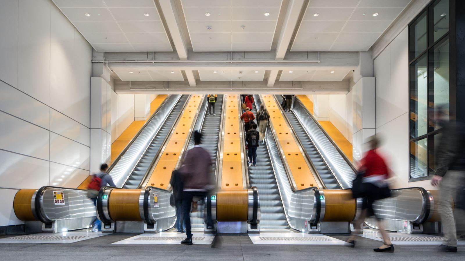 People Taking Escalators at Wynyard Train Station - Mace Group