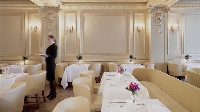 Waitress Preparing a Restaurant Table - Mace Group