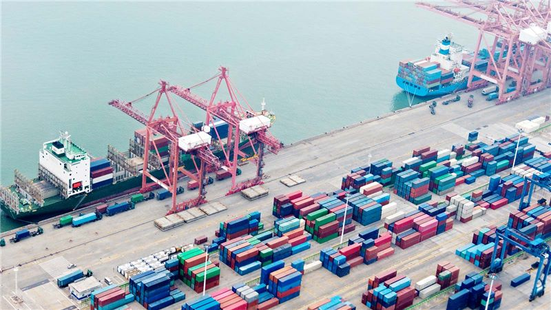 Aerial View of Ship Containers at a Sea Port - Mace Group